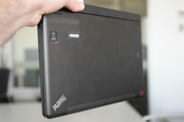 The tablet slots into the keyboard dock for transportation. Hooks and magnets hold it in place so it can't drop out.